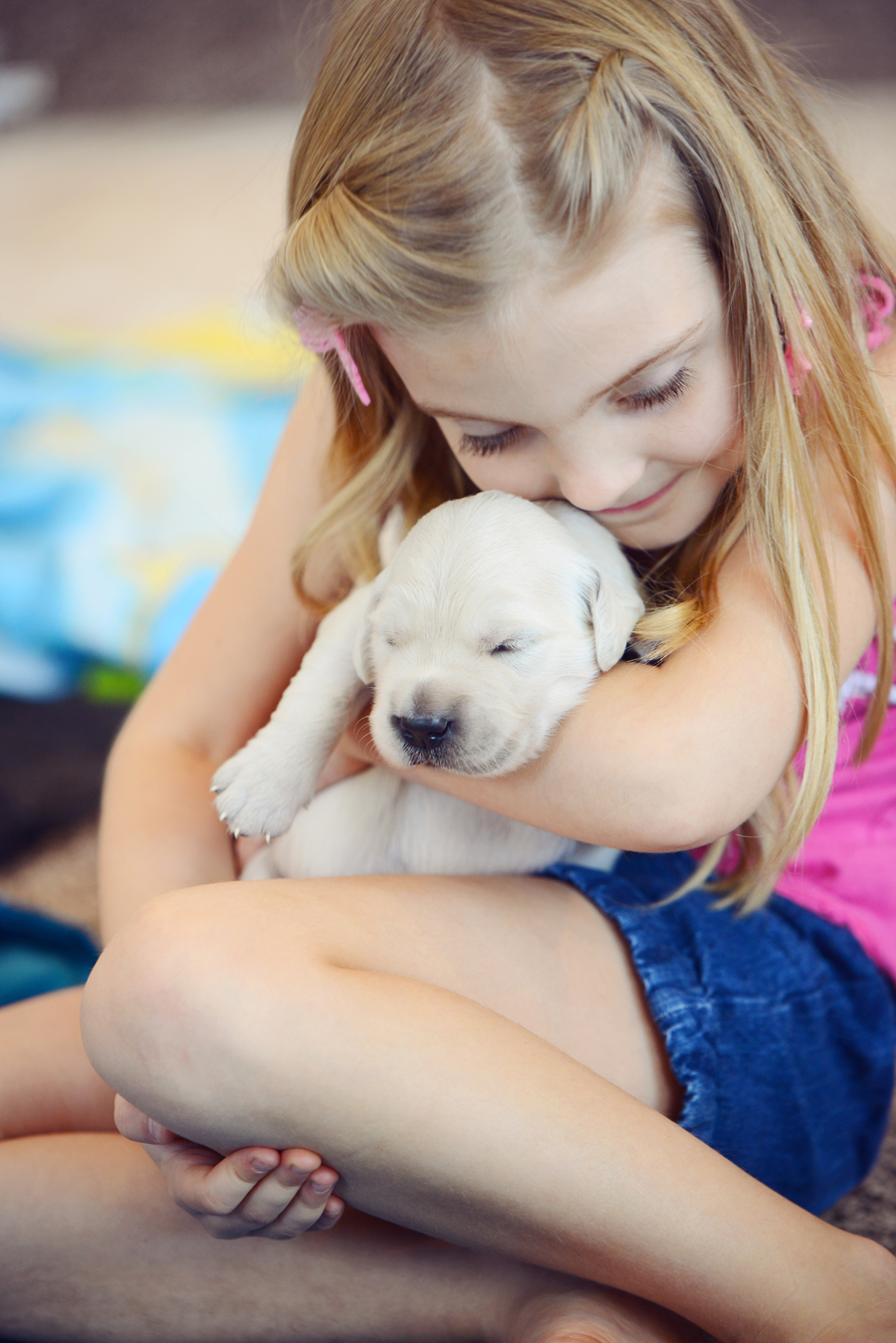 daughter holding puppy